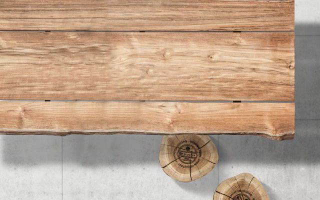 A large rectangular teak dinner table